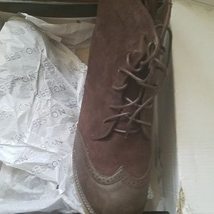 Shoes - Brown booties .. they fit more 9
